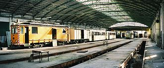 Upper Rhine Railway Company - Wrecked trains parked in carriage shed, which has since been converted for offices