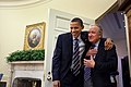 Obama greets Harkin the day after healthcare bill passed.jpg