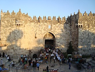 Walls of Jerusalem - Damascus Gate with its crenelations, view from North