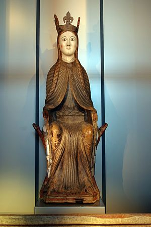 Sunniva - Medieval statue (dated c. 1200) of a seated woman wearing a crown, from Urnes Stave Church (now kept by Bergen Museum). It is interpreted as either a Madonna or as a depiction of St. Sunniva.