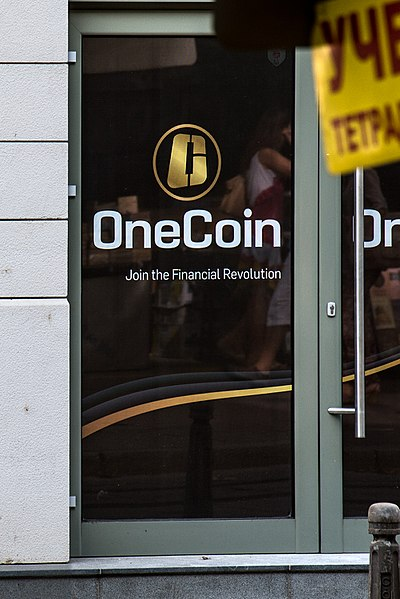 File:OneCoin logo on their office door in Sofia, Bulgaria.jpg