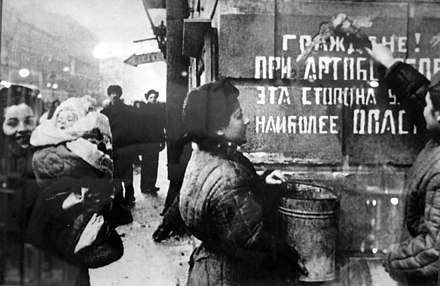 Exultant Leningrad, 1944. The sign on the wall says: Citizens! This side of the street is the most dangerous during the artillery barrage. Opasna eta storona.jpg