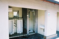 A picture of a toilet room in Japan toilet that has no door.