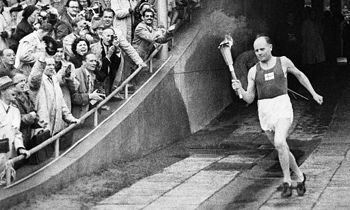 Paavo Nurmi enters the Olympic Stadium in 1952