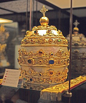 Papal tiara - A papal tiara adorned with sapphires, rubies, emeralds and other gems. Saint Peter's Basilica, Vatican City.