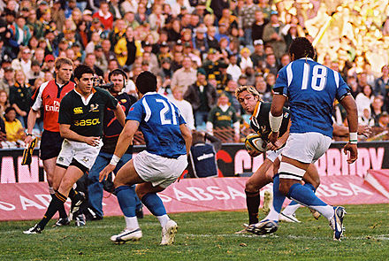 Samoa (blue) vs. South Africa in June 2007. Percy Montgomery against Samoa.jpg