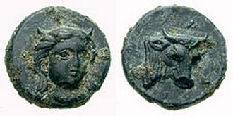 Cyme (Aeolis) - Aeolis, Larissa Phrikonis. ca 4th Century BC. Æ 11mm. Horned (?), three-quarter facing female head, turned slightly right, in necklace / LA, bull's head right.