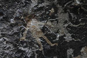 Salvadorans -  Humanoid petroglyph in Holy Spirit Grotto (corinto cave), Morazan, El Salvador.
