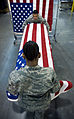Placing a U.S. flag over a casket.jpg