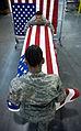 Placing a U.S. flag over a casket.jpg
