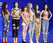 Pop group T-ara is greeting on stage during the launch ceremony for Team Korea on September 11, 2014.jpg