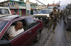 United Nations Stabilisation Mission in Haiti - U.S. Marines patrol the streets of Port-au-Prince in March 2004.