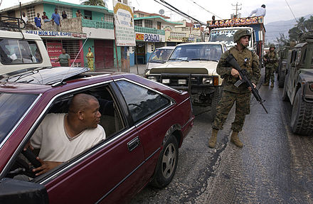 U.S. Marines patrol the streets of Port-au-Prince on 9 March 2004 Port-au-Prince med.jpg