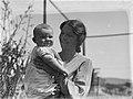 Portrait of woman holding baby (AM 79627-1).jpg