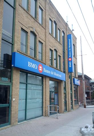 Bank of Montreal - Branch at Little Portugal, Toronto, with Banco de Montreal signage in Portuguese