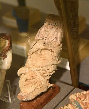 Ushabti - Pottery ushabti (shabti, shawabti) with linen grave clothes of T3y-ms. 19th Dynasty. From Heracleopolis Magna, Egypt. The Petrie Museum of Egyptian Archaeology, London