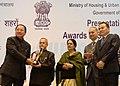 Pranab Mukherjee presenting the award to Mizoram (received by the Chief Minister of Mizoram, Shri Pu Lal Thanhawla) for effective Implementation of Jawaharlal Nehru National Urban Renewal Mission (JnNURM).jpg