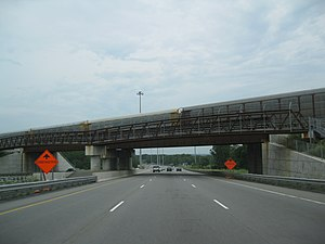 Queen Elizabeth Way - Many sections of the Queen Elizabeth Way have been reconstructed in recent years. Shown here is a rail overpass just west of Highway 405 in 2005 and 2009, respectively.