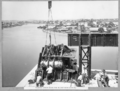 Queensland State Archives 3599 Placing lower chord pin in east main bearing Brisbane 8 October 1937.png