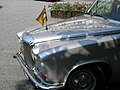 Raffles - front of Daimler DS420 with flag.jpg