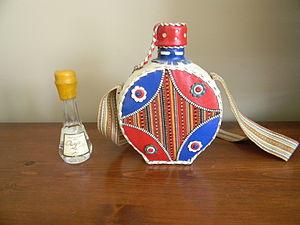 Rakia - Quince rakija from Serbia in traditional flasks