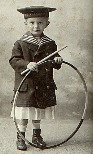 Toy - A boy with a hoop. Hoops have long been a popular toy across a variety of cultures.
