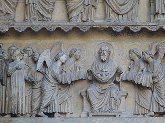 """Bosom of Abraham - Abraham holding little figures of souls in a cloth, representing the """"bosom"""", as angels bring additional figures. Reims Cathedral"""