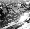 Rendu Glacier, valley glacier with dark lateral moraines, hanging glaciers and icefall, August 29, 1964 (GLACIERS 5809).jpg