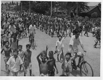 Operation Jurist - Japanese prisoners of war being marched through the streets of George Town on 3 September 1945.