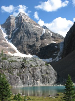 Ringrose Peak soars above a pond near Lake O'H...