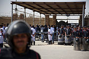 Riot police outside Mubarak courthouse