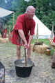Roman soldier in tunica cooking.jpg
