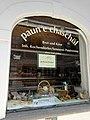 Romanischsprachiges Geschäftsfenster in Samadan.jpg