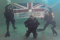 Royal Navy Divers Hold the Armed Forces Day Flag MOD 45153971.jpg