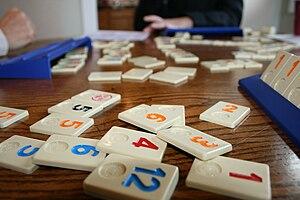 Rummikub - A selection of Rummikub tiles and racks.