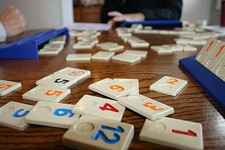 <i>Rummikub</i> tile-based game for two to four players