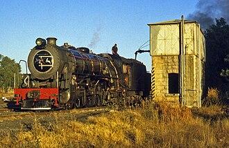 South African Class 16DA 4-6-2 1930 - No. 876 taking water at Thaba Nchu, 4 July 1999