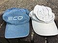 SCO Group two baseball caps.jpg