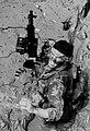 SEAL moves through deep mud making his way ashore from a boat.jpg