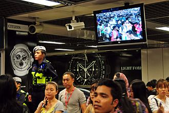 Public Transport Security Command - A TransCom surveying human traffic in the immediate hours after the 2010 New Year's Day celebrations at City Hall MRT Station. The human traffic shown on the video screen is fed from a surveillance camera.