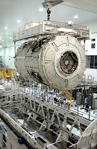 Space Station Processing Facility - Interior of the SSPF, showing Node 2 being hoisted by overhead cranes
