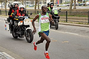 Samuel Wanjiru - Samuel Wanjiru, breaking a world record in the 2007 Fortis City-Pier-City Half Marathon