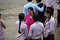 School teacher and children at break time in the yard of Jana Bikash Secondary School, Matatirtha. (10720379076).jpg