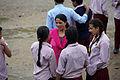 School teacher and children at break time in the yard of Jana Bikash Secondary School, Matatirtha. (10720379076).jpg