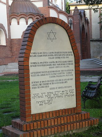 """History of the Jews in Serbia - Memorial plaque dedicated to 4,000 Jews of Subotica died in the Holocaust. The tombstone states: """"In memory of the 4000 Jews with whom we lived and built Subotica together who perished in fascist death camps in World War II."""""""