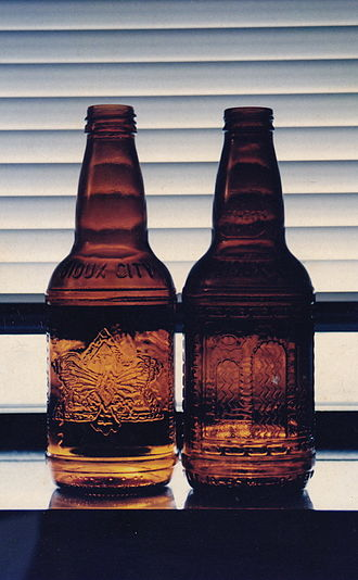 Sarsaparilla (soft drink) - Two historical Sioux City sarsaparilla bottles, as used in retail sale for decades by Sioux City brand from United States, until the 2010s