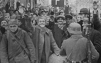 World War II in Yugoslav Macedonia - Macedonian soldiers surrendering in Skopje, April 1941. The Germans scattered leaflets in Bulgarian, prepared by the BAC, which appealed that Macedonia is set free. As result Macedonians mobilized in the Yugoslav army surrendered en masse.