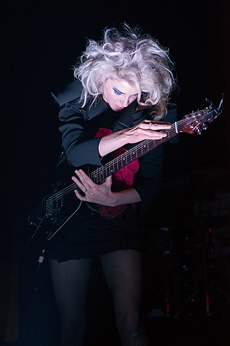 "St. Vincent (musician) - St. Vincent performing in concert during her ""Digital Witness"" tour in 2014"
