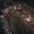 Star birth in Messier 83 (captured by the Hubble Space Telescope).jpg