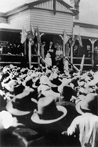 StateLibQld 1 174439 Crowds gathered at the Stanthorpe Railway Station to greet the Duke and Duchess of York, April 1927.jpg